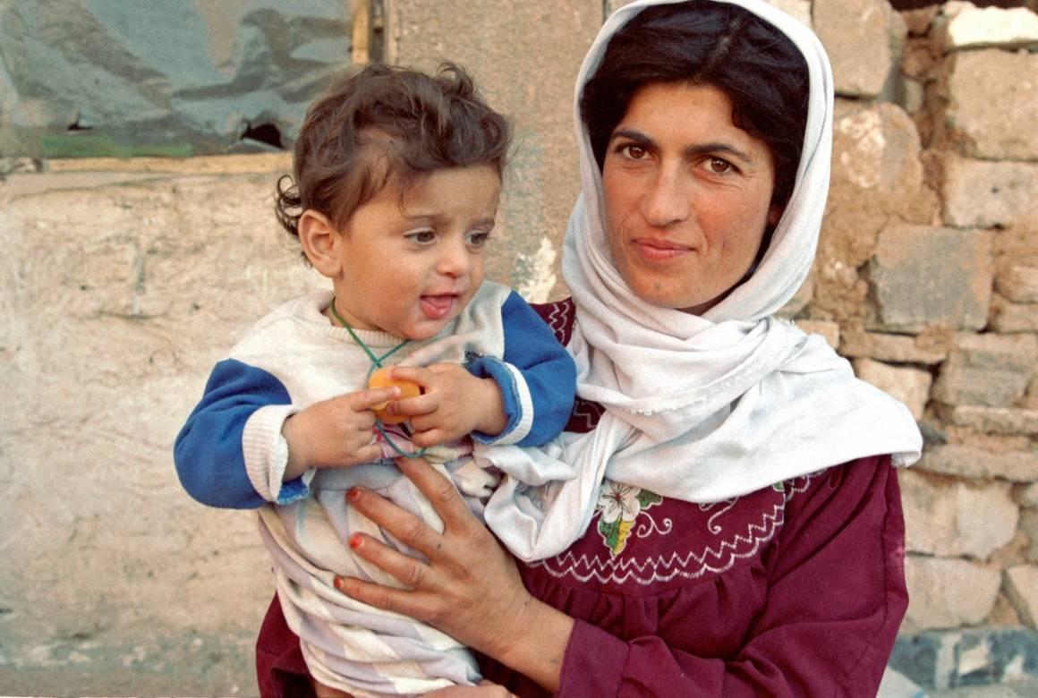 Äiti ja lapsi Suleimaniyahissa sijaitsevalla pakolaisleirillä pohjois-Irakissa.Kuva: UN Photo/Pernaca Sudhakaran